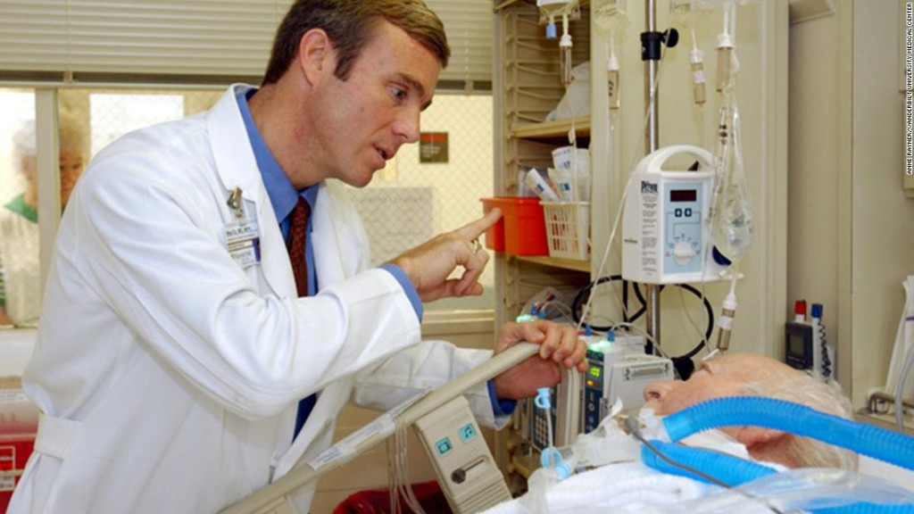 Dr. Wes Ely assesses George Scharber, a patient in MICU, using the RASS scale.